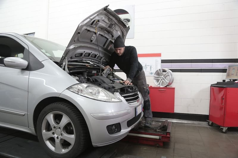 Man replacing automatic transmission